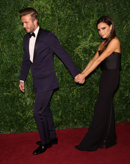 The dad-of-four led his wife down the red carpet as he clutched onto his hand for dear life [Wenn]
