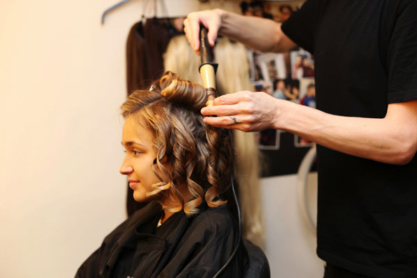 The styling team prep Lauren's hair before separating it into sections to curl [TRESemme]