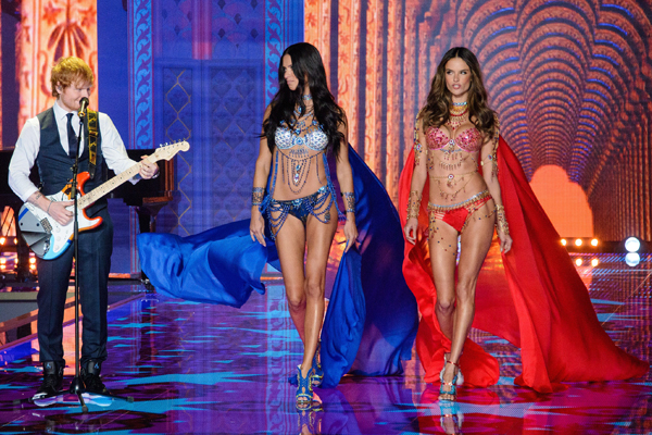 The shy singer scored his dream gig accompanying two of the lingerie brand's hottest assets down the runway [Splash]