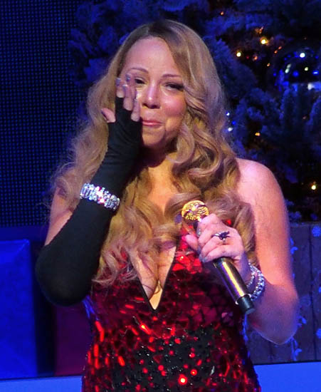 Mariah breaks down in tears on stage during a live performance